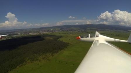 Lot Szybowcem przy Wzlocie za Samolotem